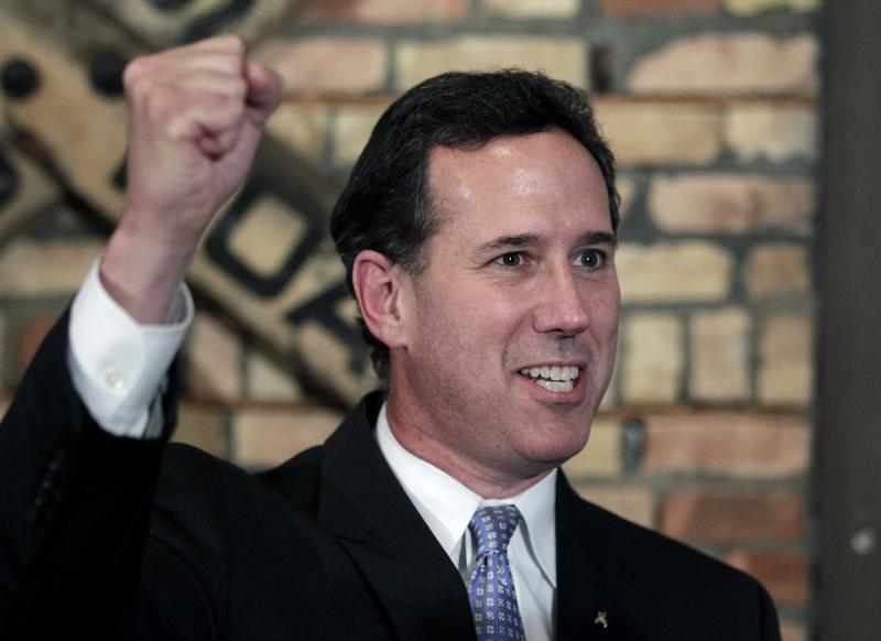 Republican presidential candidate, former Pennsylvania Sen. Rick Santorum pumps his fist while talking to reporters during a news conference in Green Bay, Wis., Saturday, March 24, 2012. Rick Santorum won the Louisiana Republican presidential primary Saturday, beating front-runner Mitt Romney in the race to challenge President Barack Obama. (AP Photo/Jae C. Hong)