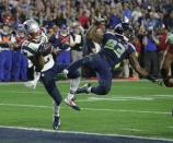 FILE - In this Feb. 1, 2015, file photo, New England Patriots cornerback Malcolm Butler (21) intercepts a pass intended for Seattle Seahawks wide receiver Ricardo Lockette (83) during the second half of the Super Bowl NFL football game in Glendale, Ariz. After Seattle eschewed giving the ball to hard-running Marshawn Lynch at the goal line, Butler made the game-saving interception for New England. (AP Photo/Kathy Willens, File)