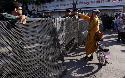 <span>A Buddhist monk tries to enter a blocked street outside the supreme court on Thursday</span> <span>Credit: AP </span>