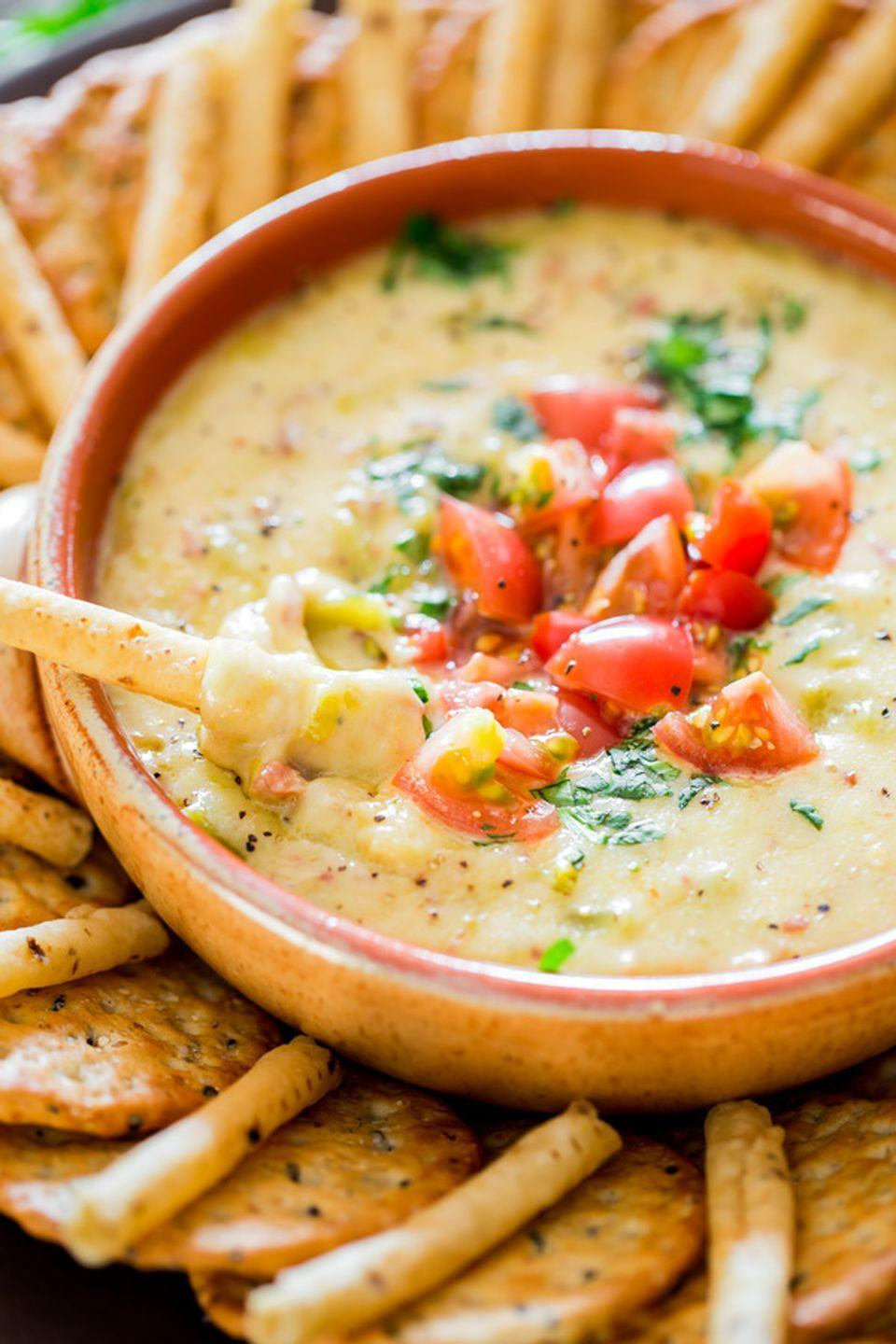 "<p>Trust us: You're going to be scraping the bottom of the bowl for one last bite of this dip.</p><p><strong>Get the recipe from <a href=""http://www.jocooks.com/main-courses/pork-main-courses/crockpot-bacon-queso-blanco-dip/"" rel=""nofollow noopener"" target=""_blank"" data-ylk=""slk:Jo Cooks"" class=""link rapid-noclick-resp"">Jo Cooks</a>.</strong></p>"