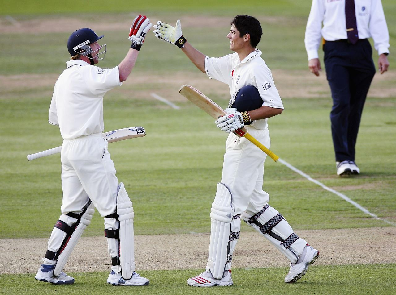 LONDON - JULY 13:  England batsmen Paul Collingwood (L) and Alastair Cook (R) shake hands after Cook had reached his century during the first day of the npower test match between England and Pakistan at Lords on July 13, 2006, in London, England.  (Photo by Stu Forster/Getty Images)