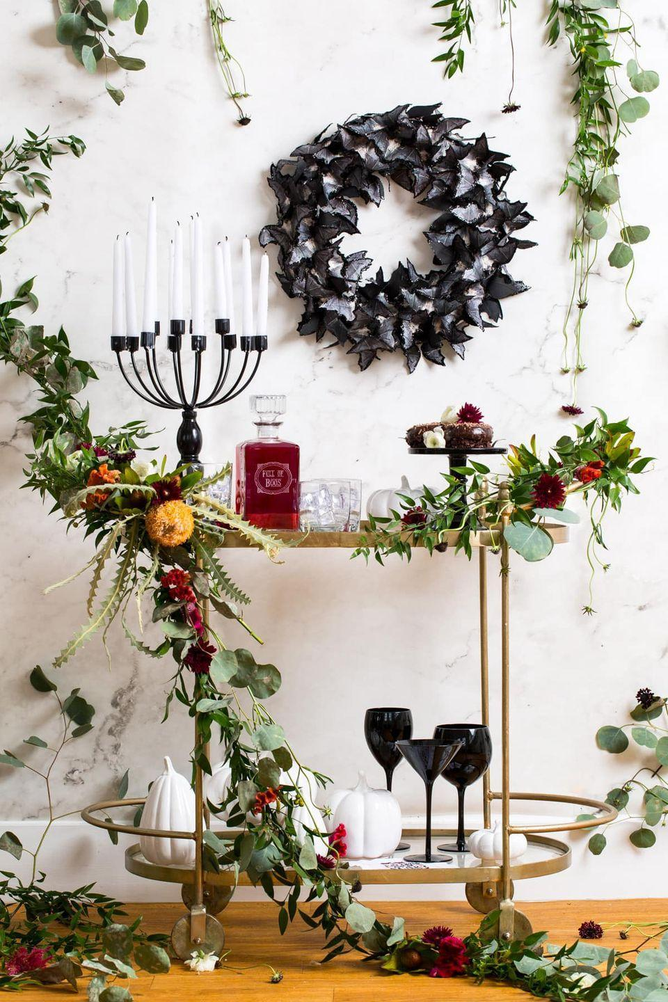 "<p>Don't forget to spruce up the bar cart while you're at it! Learn how to make this gorgeous garland (which also works for the fireplace or as a centerpiece) from <a href=""https://sugarandcloth.com/spooky-diy-floral-bar-cart-for-halloween/"" rel=""nofollow noopener"" target=""_blank"" data-ylk=""slk:Sugar & Cloth"" class=""link rapid-noclick-resp"">Sugar & Cloth</a>.</p><p><a class=""link rapid-noclick-resp"" href=""https://www.amazon.com/Anodized-Aluminum-Training-Multipurpose-Crafting/dp/B078QZSTSB/ref=sr_1_2?tag=syn-yahoo-20&ascsubtag=%5Bartid%7C10057.g.2554%5Bsrc%7Cyahoo-us"" rel=""nofollow noopener"" target=""_blank"" data-ylk=""slk:BUY NOW"">BUY NOW</a> <strong><em>Floral Wire, $12</em></strong></p>"