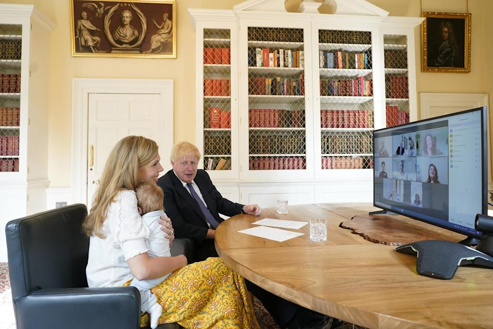 The Prime Minister Boris Johnson and his partner Carrie Symonds with their son Wilfred in the study of No. 10 Downing Street speaking via zoom to the midwifes that helped deliver their son at the UCLH. (Andrew Parsons/No10 Downing St)