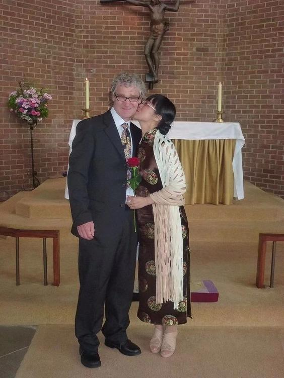 Min, here with Dan, cannot visit her ill father in China for fear she will not be allowed back into Britain