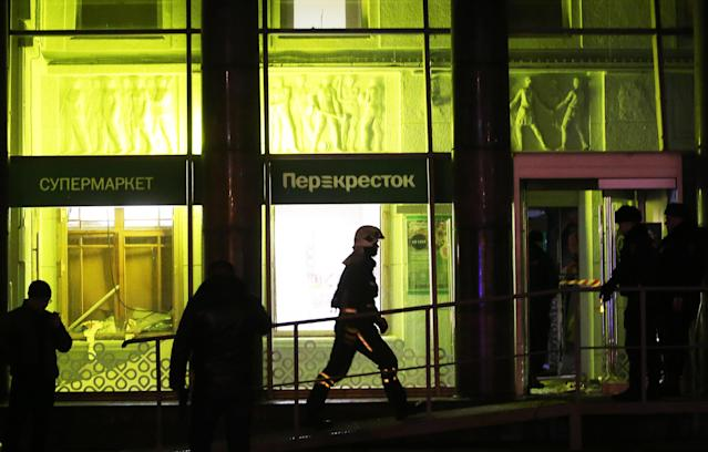 <p>Firefighters seen by the Perekrestok supermarket in Kalinina Square, St. Petersburg, Russia on Dec. 27, 2017. An explosion inside the store has injured several people. (Photo: Alexander Demianchuk/TASS via Getty Images) </p>