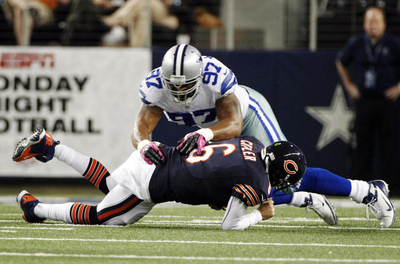 Dallas Cowboys defensive end Jason Hatcher (97) lands on Chicago Bears quarterback Jay Cutler (6) after Cutler was sacked by Cowboys' DeMarcus Ware during the first half of an NFL football game, Monday, Oct. 1, 2012, in Arlington, Texas. (AP Photo/LM Otero)