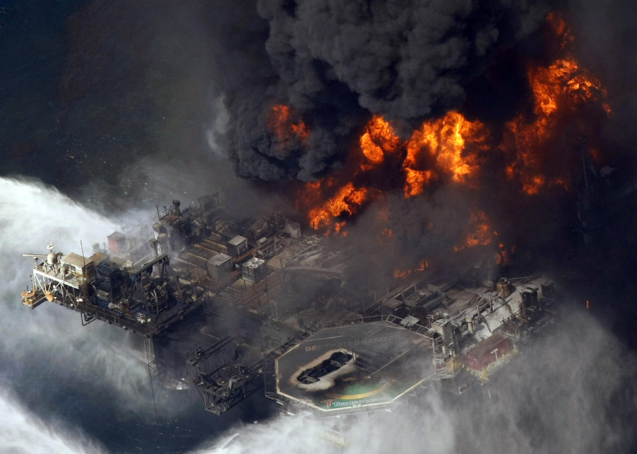 FILE - In this April 21, 2010 file photo taken in the Gulf of Mexico more than 50 miles southeast of Venice on Louisiana's tip, the Deepwater Horizon oil rig is seen burning. A BP scientist identified a previously unreported deposit of flammable gas that could have played a role in the Gulf of Mexico oil spill, but the oil giant failed to divulge the finding to government investigators for as long as a year, according to interviews and documents obtained by The Associated Press. (AP Photo/Gerald Herbert, File)