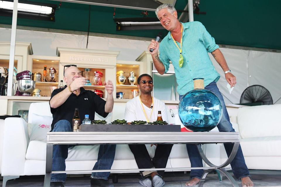 <p>Bourdain speaks onstage at the KitchenAid demonstration during the Food Network South Beach Wine & Food Festival on February 22, 2014 in Miami Beach.</p>