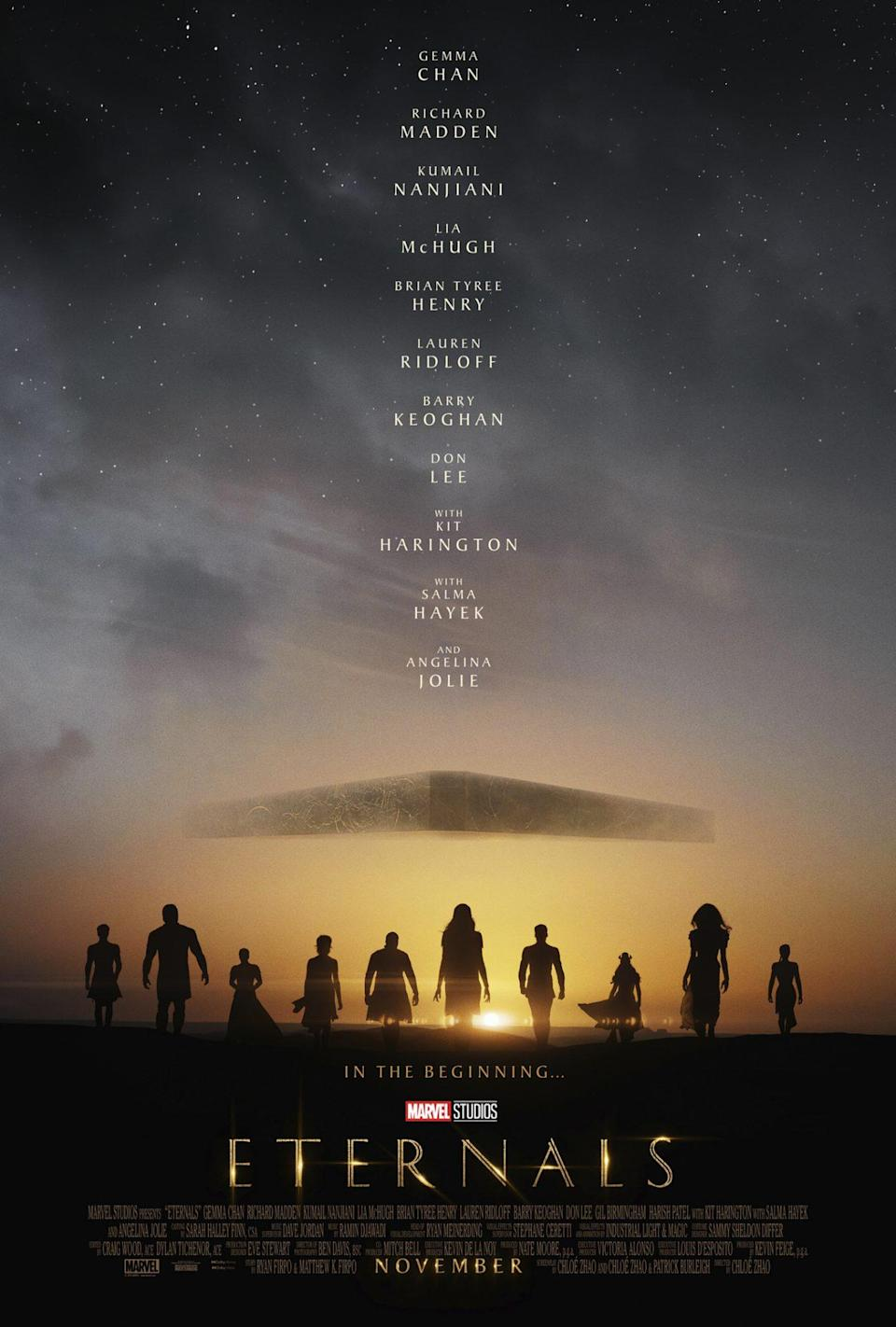 Silhouettes of the Eternals team beneath an alien spaceship in a starry sky.