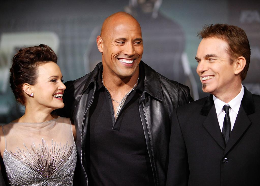 "<a href=""http://movies.yahoo.com/movie/contributor/1800024683"">Carla Gugino</a>, <a href=""http://movies.yahoo.com/movie/contributor/1808442134"">Dwayne Johnson</a> and <a href=""http://movies.yahoo.com/movie/contributor/1800018605"">Billy Bob Thornton</a> at the Los Angeles premiere of <a href=""http://movies.yahoo.com/movie/1810147419/info"">Faster</a> on November 22, 2010."