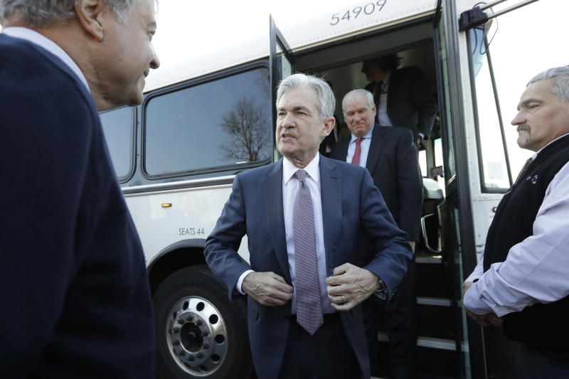 FILE - In this Nov. 25, 2019, file photo Federal Reserve Board Chair Jerome Powell, center, steps off a bus and greets people during tour of East Hartford, Conn. On Wednesday, Dec. 11, the Federal Reserve issues a statement and economic projections, followed by a news conference with Powell. (AP Photo/Steven Senne, File)