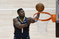 New Orleans Pelicans forward Zion Williamson (1) scores against the Atlanta Hawks in the first half of an NBA basketball game Tuesday, April 6, 2021, in Atlanta. (AP Photo/John Bazemore)