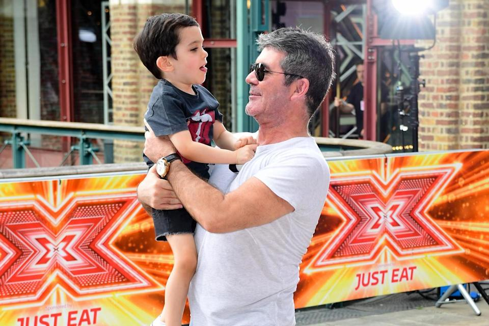 Simon Cowell and his son Eric (Ian West/PA Archive/PA Images)