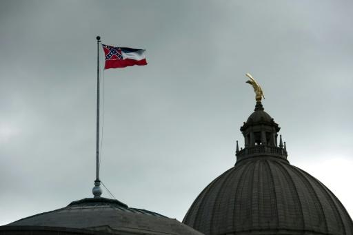The Mississippi state flag flies over the state capitol building in Jackson, Mississippi, as lawmakers voted to remove the Confederate battle symbol from the flag