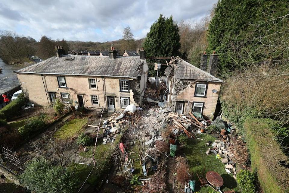 The scene in Ramsbottom, Bury, Greater Manchester, where the body of a woman was found after a house collapsed (Peter Byrne/PA) (PA Archive)