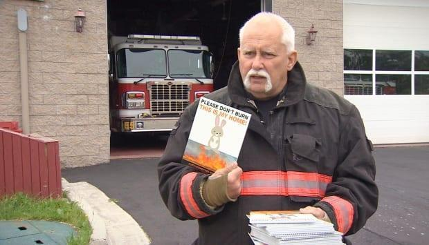 North Sydney volunteer fire Chief Lloyd MacIntosh says a campaign sparked by a scorched fox helped cut down on the number of grass fire calls this spring. (Matthew Moore/CBC - image credit)