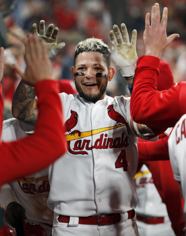 St. Louis Cardinals' Yadier Molina is congratulated by teammates in the dugout after hitting a two-run home run during the sixth inning of the team's baseball game against the Los Angeles Dodgers on Wednesday, April 10, 2019, in St. Louis. (AP Photo/Jeff Roberson)