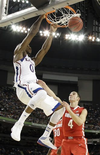 Kansas' Thomas Robinson, left, dunks over Ohio State's Aaron Craft, right, during the second half of an NCAA Final Four semifinal college basketball tournament game Saturday, March 31, 2012, in New Orleans. (AP Photo/David J. Phillip)