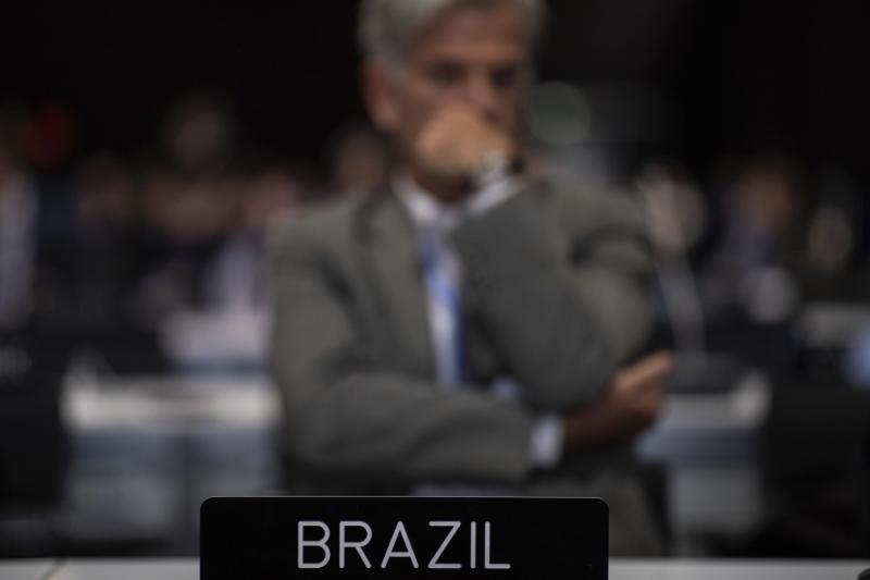 A member of the Brazil delegation during the closing plenary at the COP25 summit in Madrid, Sunday Dec. 15, 2019. Negotiators from almost 200 nations planned to gather for a final time at the U.N. climate meeting in Madrid early Sunday to pass declarations calling for greater ambition in cutting planet-heating greenhouse gases and in helping poor countries suffering the effects of climate change. But one of the key issues at the talks, an agreement on international carbon markets, has eluded officials even after the Chilean chair extended Friday's talks deadline to allow more time for negotiations. (AP Photo/Bernat Armangue)