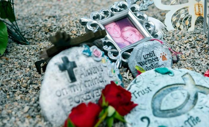 Pictured is a framed photo of Mallory Beach with her boyfriend, Anthony Cook, memorial stones and red roses set out for Valentines Day as seen at her gravesite on Friday, Feb. 21, 2020, in Sandy Run Cemetery near Varnville in Hampton County, South Carolina. Beach, 19, was killed in a boat accident in Archers Creek in Beaufort County on Feb. 24, 2020, when the boat she was in struck a bridge piling.