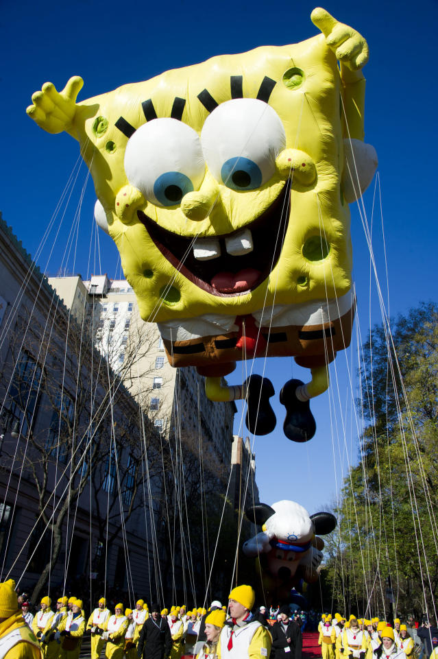 """FILE - In this Nov. 4, 2011, file photo, the SpongeBob SquarePants balloon floats in the Macy's Thanksgiving Day Parade in New York. A sense of humor and a dash of creativity, along with memes from """"The Office,"""" """"SpongeBob SquarePants"""" and the """"Real Housewives"""" franchise, helped NFL teams' social-media crews tell the story of free agency in the age of the coronavirus before deals eventually were allowed to just be announced normally. (AP Photo/Charles Sykes, File)"""