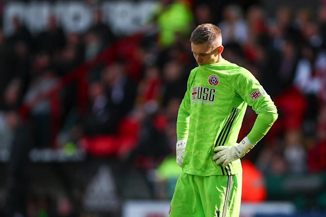 A dejected Dean Henderson after Liverpool's opener (Photo by Robbie Jay Barratt - AMA/Getty Images)