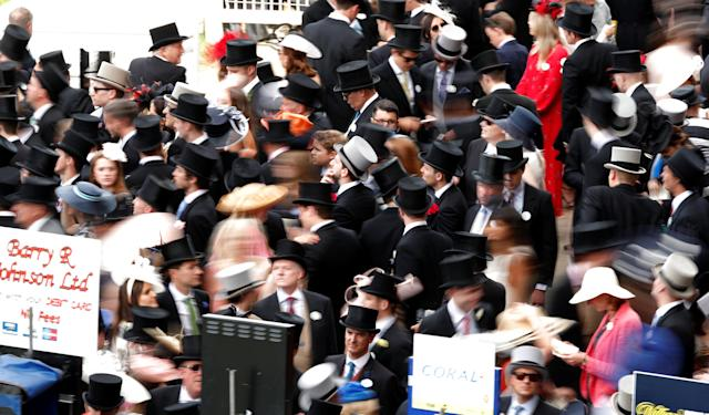Horse Racing - Royal Ascot - Ascot Racecourse, Ascot, Britain - June 23, 2018 General view of racegoers during the royal procession before the start of the racing Action Images via Reuters/Andrew Boyers
