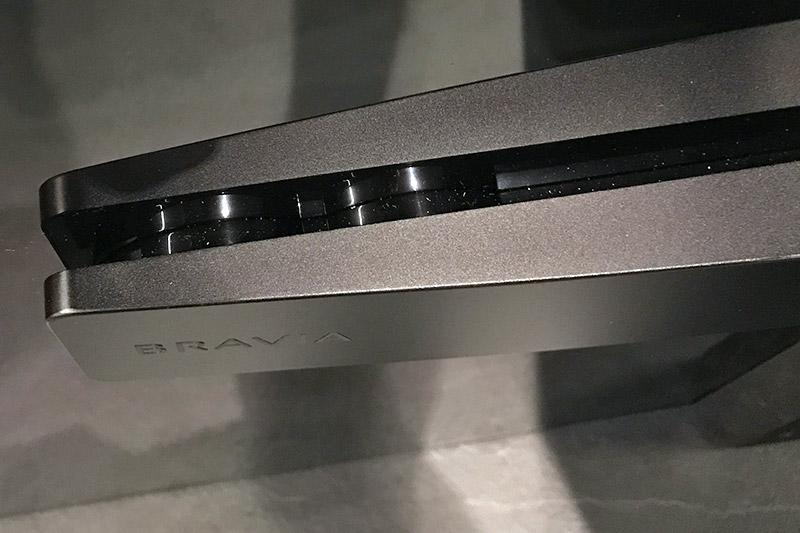 At the back of the TV, there are four actuators. Each pair takes care of its own half of the screen, and they combine to generate the stereo sound.