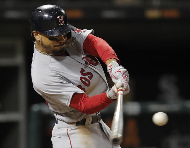 FILE - In this Thursday, Aug. 30, 2018, file photo, Boston Red Sox's Mookie Betts hits a two-run home run against the Chicago White Sox during the seventh inning of a baseball game in Chicago. Betts and the World Series champion Red Sox agreed to a $20 million, one-year contract on Friday, a $9.5 million raise for an arbitration-eligible player that topped pitcher Max Scherzer's $8.8 million raise from Detroit in 2014. (AP Photo/Jim Young, File)