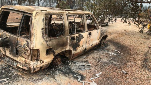 A burned vehicle is seen in the mountain community of Keswick, Calif., Sunday, July 29, 2018. On Sunday, the San Bernardino County Fire department pulled in to tamp down smoking rubble. Piles of wreckage were still smoking amid downed electricity lines. (AP)