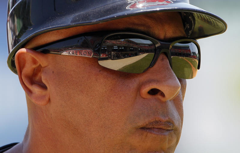 In this photo taken Wednesday, June 27, 2012, Carolina Mudcats manager Edwin Rodriguez watches closely during a minor league baseball game against the Frederick Keys in Zebulon, N.C. Rodriguez is a former manager of the Miami Marlins. (AP Photo/Gerry Broome)