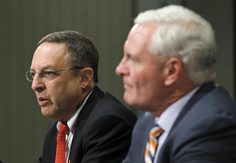 Cleveland Browns new CEO Joe Banner, left, answers questions as new owner Jimmy Haslam III listens during a news conference Wednesday, Oct. 17, 2012, in Berea, Ohio. Banner spent 19 years with the Eagles, spending 12 seasons as president before leaving the club last season. (AP Photo/Tony Dejak)