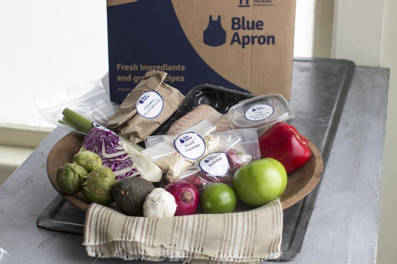 FILE - This Oct. 6, 2014, file photo shows an example of a home-delivered meal from Blue Apron. The growing options for outsourcing meal planning, grocery shopping and cooking can be called time-saving blessings or culture-destroying curses. In the end, they're probably a complicated mix of both. (AP Photo/Matthew Mead, File)