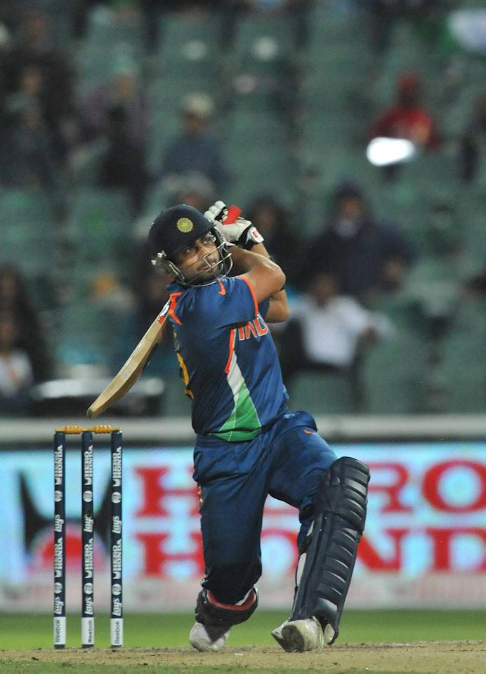 JOHANNESBURG, SOUTH AFRICA - SEPTEMBER 30: Virat Kohli of India hits a six off David Bernard of the West Indies to reach his 50 during The ICC Champions Trophy Group A Match between India and West Indies at Wanderers Stadium on September 30, 2009 in Johannesburg, South Africa. (Photo by Duif du Toit/Gallo Images/Getty Images)