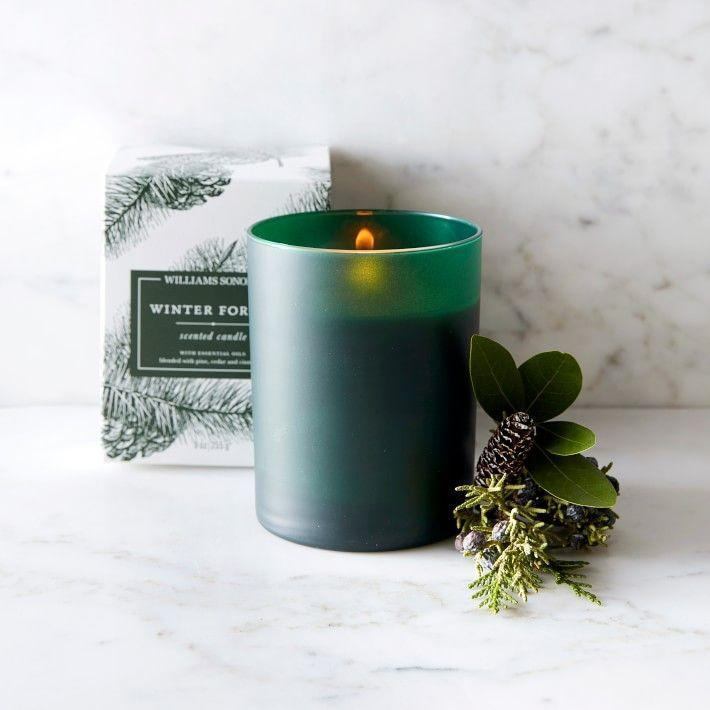"""<p><strong>Williams Sonoma </strong></p><p>williams-sonoma.com</p><p><strong>$19.95</strong></p><p><a href=""""https://go.redirectingat.com?id=74968X1596630&url=https%3A%2F%2Fwww.williams-sonoma.com%2Fproducts%2Fwilliams-sonoma-essential-oils-boxed-candle-winter-forest&sref=https%3A%2F%2Fwww.housebeautiful.com%2Fshopping%2Fhome-accessories%2Fg22998163%2Fbest-christmas-scented-candles%2F"""" rel=""""nofollow noopener"""" target=""""_blank"""" data-ylk=""""slk:BUY NOW"""" class=""""link rapid-noclick-resp"""">BUY NOW</a></p><p>For an added touch, you can have this pine-, cedar-, and cinnamon-scented candle monogrammed. Yes, really! </p>"""