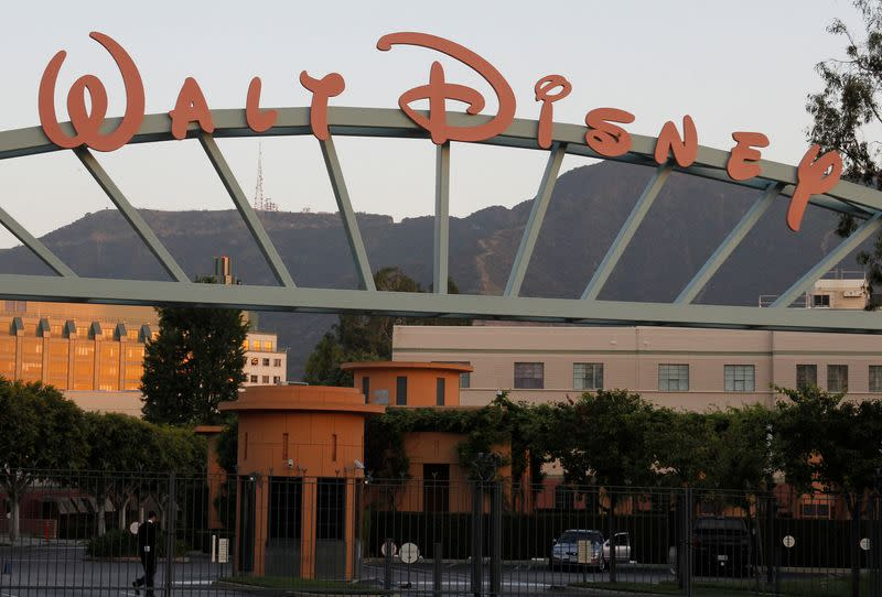 FILE PHOTO: A portion of the signage at the main gate of The Walt Disney Co. is pictured in Burbank, California