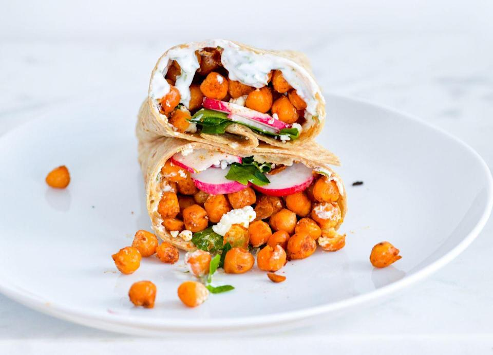 """<p>Sometimes a sandwich is perfect for dinner—especially when it contains a nice amount of protein to fill you up or after a tough workout when you need some extra carbs. This chickpea wrap by<a href=""""https://nutritionalanatalie.com/spiced-chickpea-wrap-with-lemon-dill-yogurt-sauce/"""" rel=""""nofollow noopener"""" target=""""_blank"""" data-ylk=""""slk:Nutrition a la Natalie"""" class=""""link rapid-noclick-resp""""> Nutrition a la Natalie</a> is incredibly savory, thanks to salty feta, creamy yogurt sauce, and spiced chickpeas to provide a nice balance of flavor.</p>"""