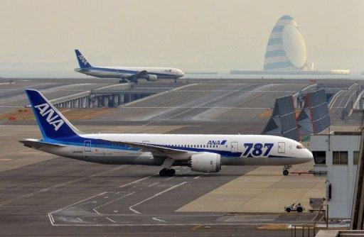 <p>An All Nippon Airways' (ANA) Boeing 787 Dreamliner is towed at Tokyo's Haneda airport, January 16, 2013. ANA is grounding its fleet of Dreamliners until at least the end of May, with no end in sight to woes for Boeing's next generation plane.</p>