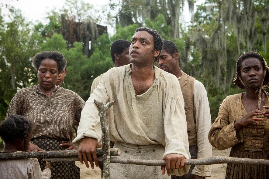 "This image released by Fox Searchlight shows Chiwetel Ejiofor, center, in a scene from the film, ""12 Years A Slave."" The film was nominated for a Directors Guild award on Tuesday, Jan. 7, 2014. The winners will be announced on Jan. 25. (AP Photo/Fox Searchlight, Jaap Buitendijk)"
