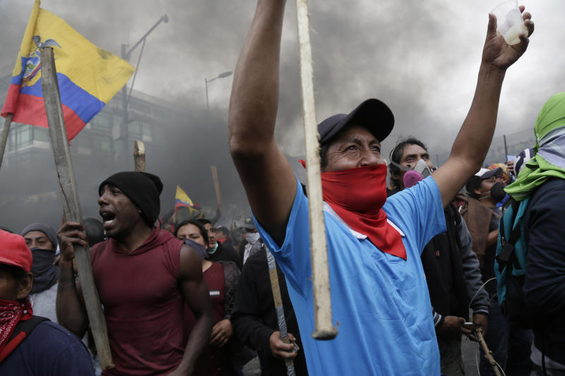 Anti-government protesters, including indigenous people, clash with police near the National Assembly in Quito, Ecuador, Tuesday, Oct. 8, 2019. Anti-government protests, which began when President Lenín Moreno's decision to cut subsidies led to a sharp increase in fuel prices, has persisted for days and clashes led the president to move his besieged administration out of Quito. (AP Photo/Dolores Ochoa)