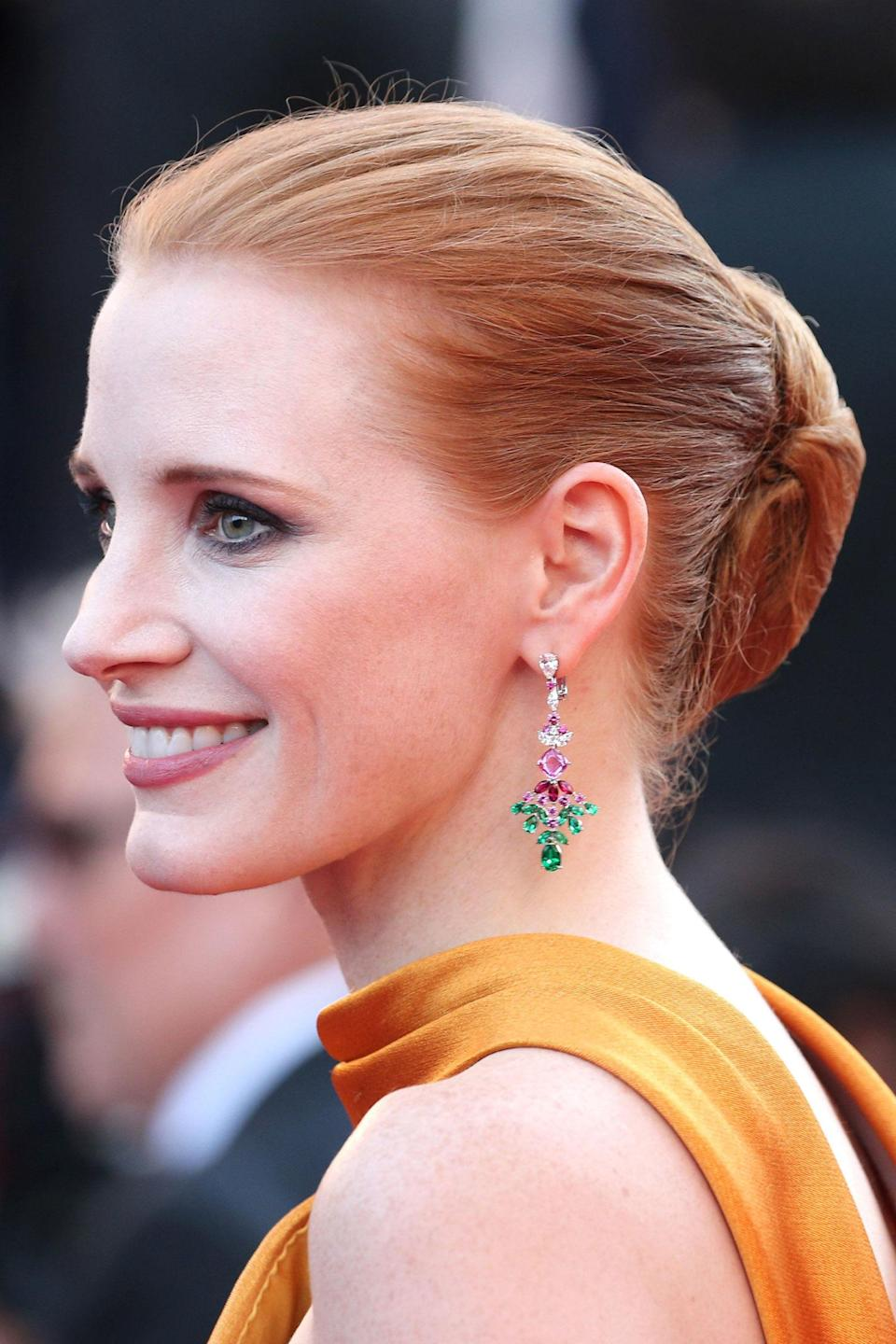 <p>Chastain upped the ante for the 70th Anniversary screening, wearing her iconic locks in a jumbo bun and intense smoky eye make-up.</p>