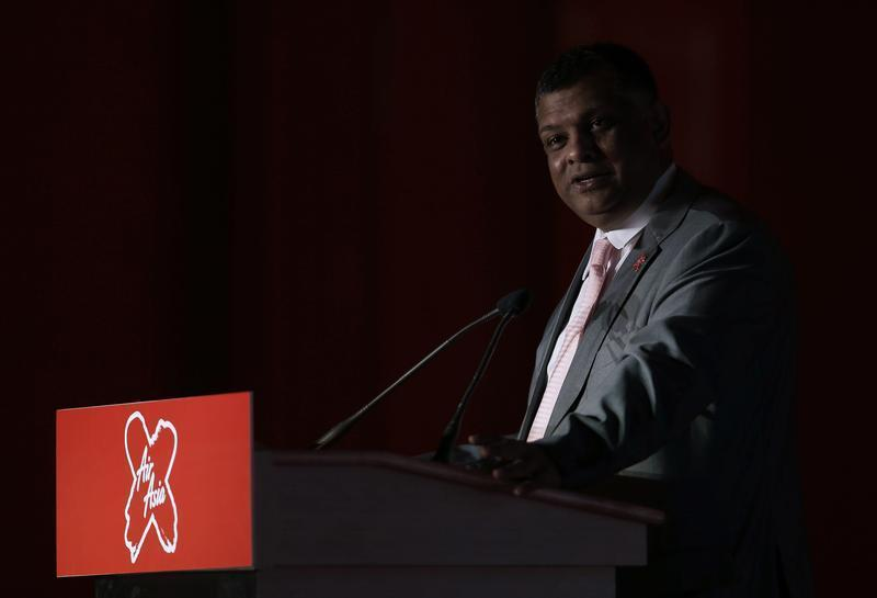 Founder of long-haul carrier AirAsia X Fernandes delivers his keynote address during the launch of the company's prospectus in Kuala Lumpur