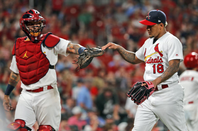 St. Louis Cardinals starting pitcher Carlos Martinez, right, is congratulated by catcher Yadier Molina after getting Atlanta Braves' Dansby Swanson to ground out ending the top of the eighth inning of a baseball game Sunday, May 26, 2019, in St. Louis. (AP Photo/Jeff Roberson)