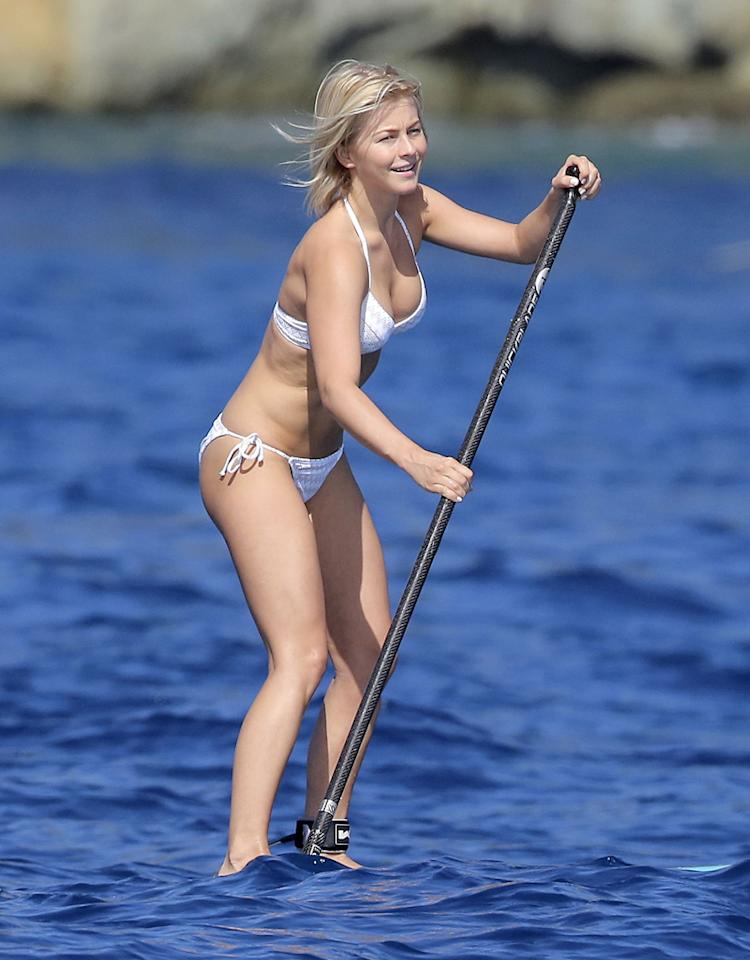 "Hough told <em>InStyle Makeover</em> in September that her relationship with Seacrest has been great for her heart, but not as good for her waistline. ""I'm 20 pounds heavier than I was when we started dating,"" she said. Well, she looked pretty perfect while paddling in her white bikini. Some of her other favorite workouts include ballet classes, SoulCycle, and swimming, she recently told <em>WebMD</em> magazine. (1/2/2013)"