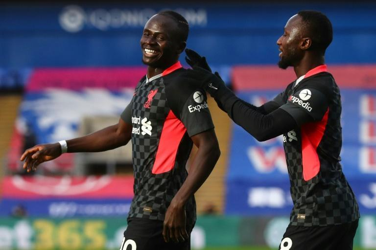 Liverpool forward Sadio Mane (left) celebrates scoring against Crystal Palace