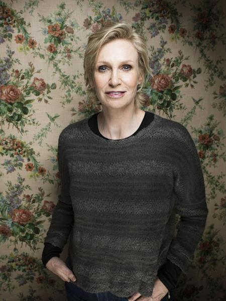 "FILE - This Jan. 21, 2013 file photo shows actress Jane Lynch during the 2013 Sundance Film Festival at the Fender Music Lodge in Park City, Utah. Lynch said Wednesday, Feb. 20, she'll be replacing Tony Award-winning actress Katie Finneran as the evil orphanage matron Miss Hannigan in the current revival of ""Annie."" A veteran of Chicago's Steppenwolf Theatre Company, she will play Hannigan for eight weeks, from May 16 through July 14. (Photo by Victoria Will/Invision/AP, file)"