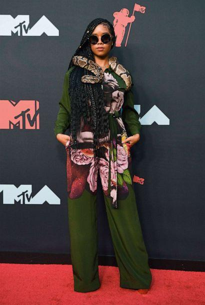 PHOTO: Singer Gabriella Wilson, aka H.E.R., arrives for the 2019 MTV Video Music Awards at the Prudential Center in Newark, N.J. on Aug. 26, 2019. (Johannes Eisele/AFP/Getty Images)