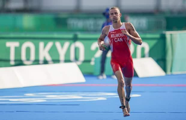 Canadian triathlete Tyler Mislawchuk has withdrawn from the mixed team relay event at the Tokyo Olympics on Friday due to an Achilles injury he sustained in last Sunday's individual race. (Leah Hennel/The Canadian Press - image credit)