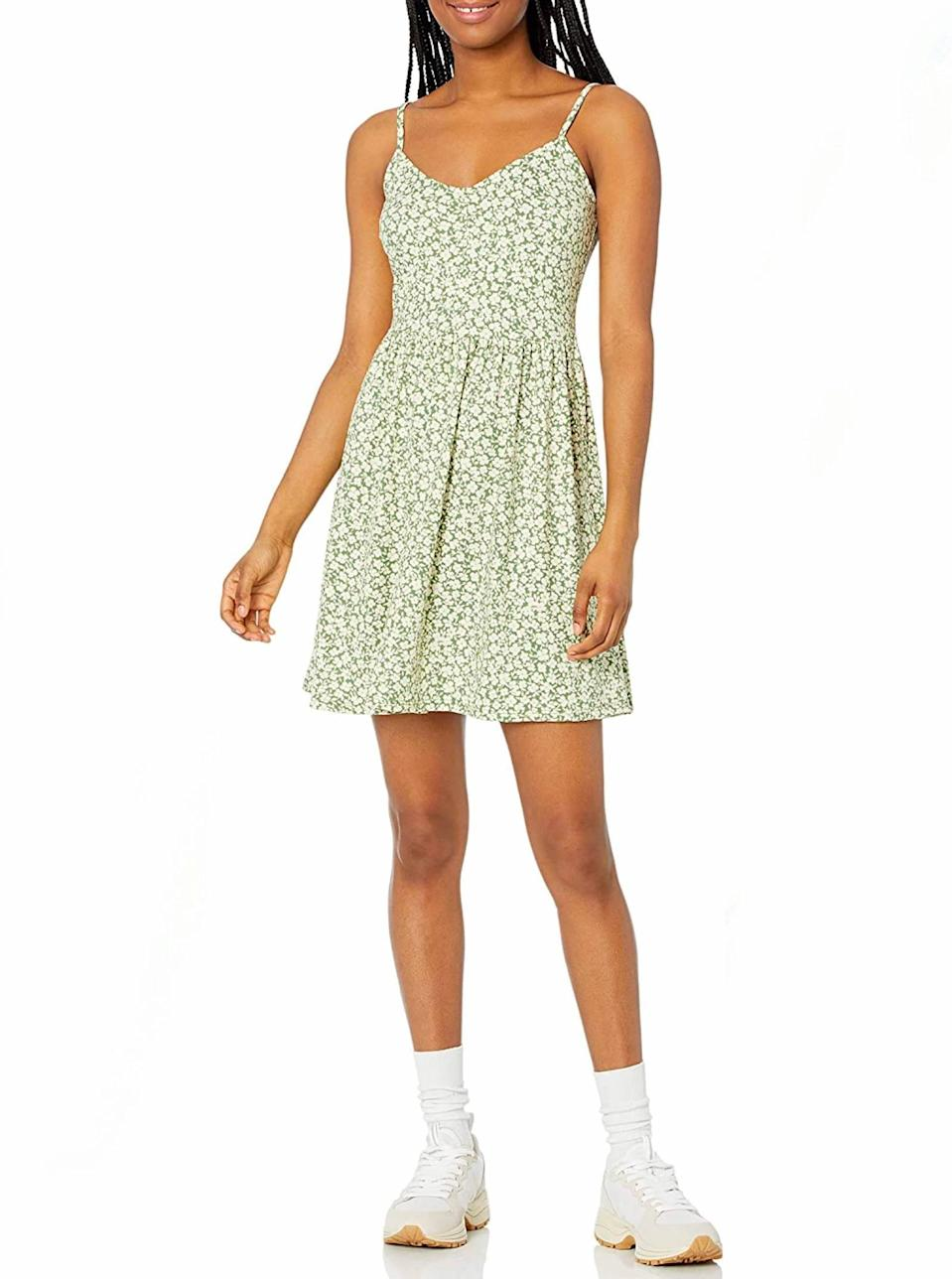 """A daintier green cami dress for when you're listening to the angel on your shoulder instead. $23, Amazon. <a href=""""https://www.amazon.com/Amazon-Brand-Spaghetti-Printed-X-Large/dp/B08MW1BKKF/"""" rel=""""nofollow noopener"""" target=""""_blank"""" data-ylk=""""slk:Get it now!"""" class=""""link rapid-noclick-resp"""">Get it now!</a>"""