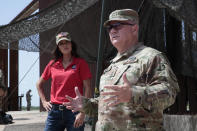 South Dakota Gov. Kristi Noem visited the U.S. border with Mexico on Monday, July 26, 2021, near McAllen, Texas. The Republican governor deployed roughly 50 National Guard troops to help with Texas' push to arrest people crossing illegally and charge them with state crimes. (AP Photo/Stephen Groves)